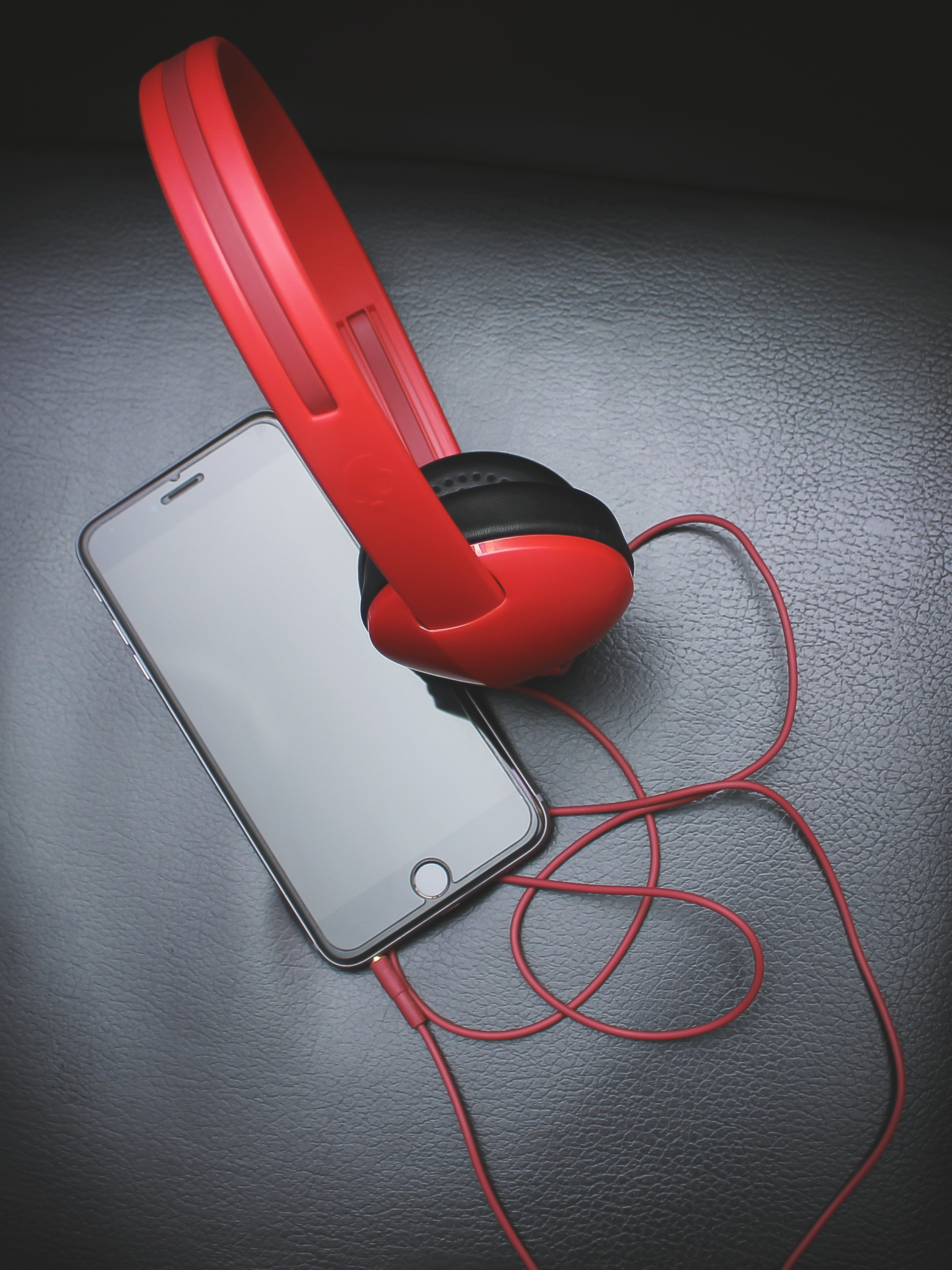 iPhone with red headphones plugged in  for blog submission request at official cam takeova dot com