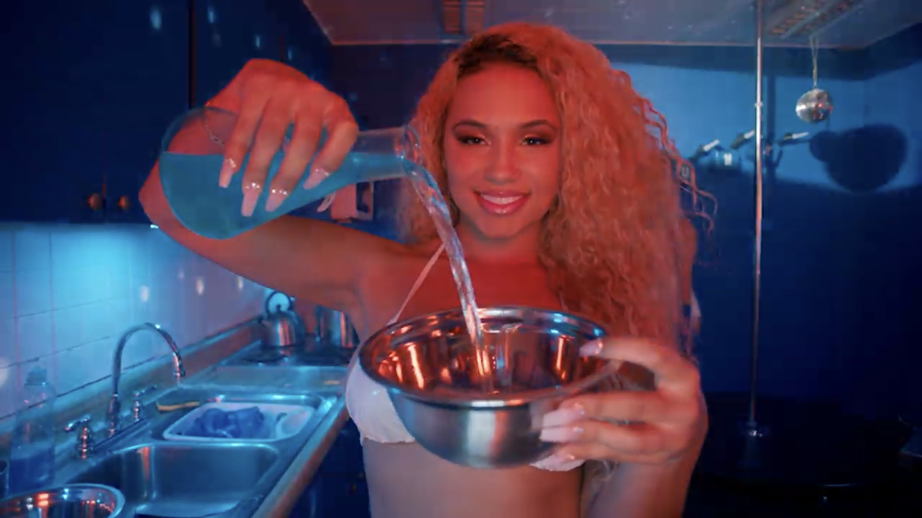 beautiful woman pouring blue liquid into silver bowl crunk ain't dead video