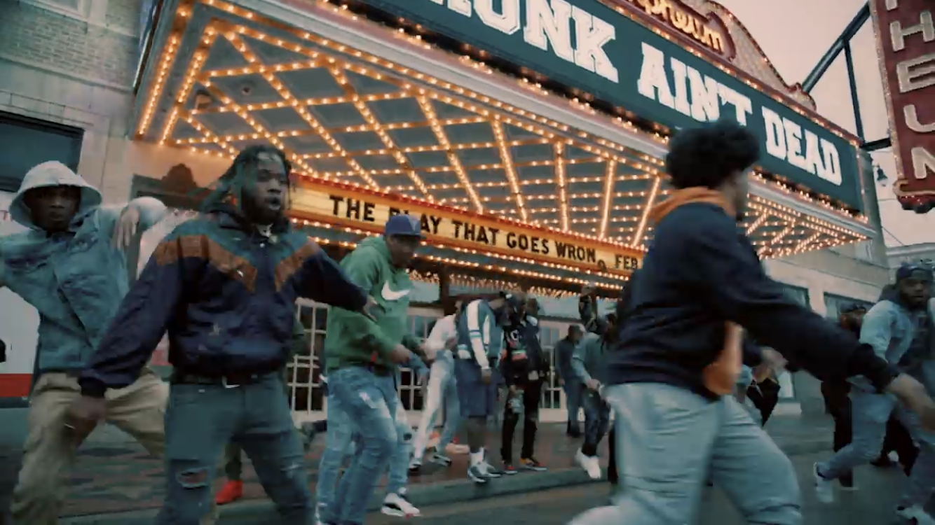 group of black men dancing in front of orpheum theatre