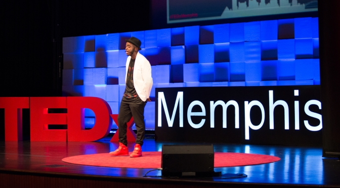 Black male conscious rapper marco pave speaking on stage